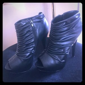 Steve Madden peep toe ruched leather bootie.